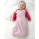 Baby in Marselme Merino Nightdress that is untied.