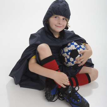Boy ready for Footnball is Marselme Playtime Raincape.